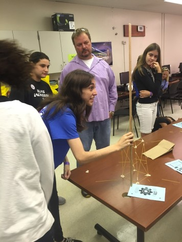 Julia Berger, a senior in the OH Engineering Academy measures a tower built using only spaghetti noodles, one marshmallow, and one strip of tape. The tower building  exercise was just one of the G.E.T. day activities.