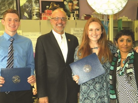 U.S. Congressman Ted Deutch (second from left) presented Olympic Heights Engineering Academy students Jared Spector (far left) and Kaylee Cunningham (third from left) with Congressional Commendations for winning a computer application design competition. Engineering teacher Ms. Nimmi (far right) was on hand for the presentation.