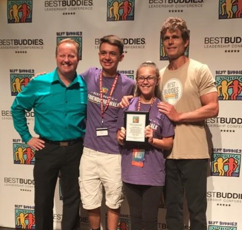 Best Buddies Olympic Heights chapter president Jacob Pasternack (second from left) and vice-president Tara Rubin (third from left) accept an award from Best Buddies International Senior Vice-President David Quilleon (extreme left) and Best Buddies International founder and chairman Anthony Kennedy Shriver (extreme right).