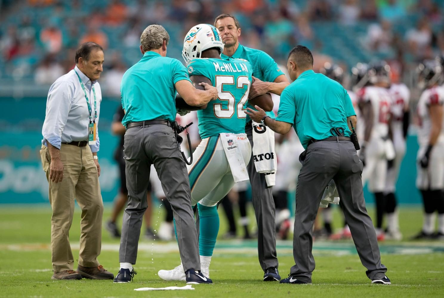 Miami Dolphins second round draft pick and projected starting middle linebacker Raekwon McMillan is helped off the field after tearing his ACL on the opening kickoff of the first game of the 2017 pre-season. He is out for the season.