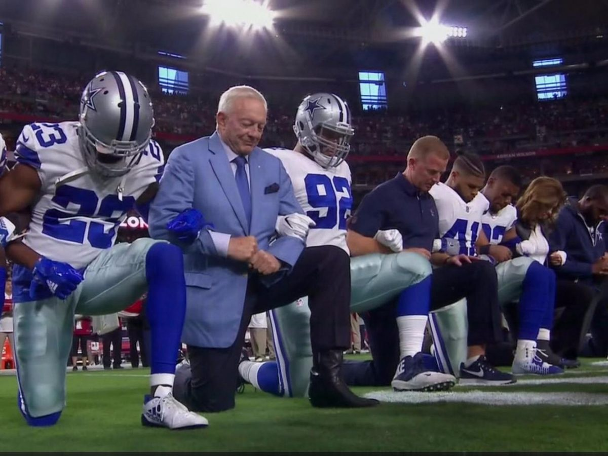 Team+owner+and+Trump+supporter+Jerry+Jones+kneels+with+the+Dallas+Cowboys+prior+to+the+national+anthem+on+Monday%2C+Sept.+25.+The+team+did+stand+with+locked+arms+during+the+singing+of+the+anthem%2C+however.