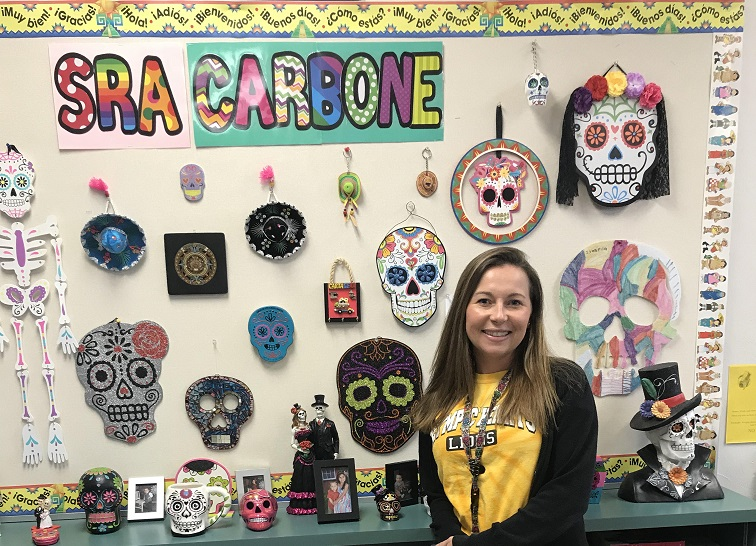 OH+Spanish+teacher+Ms.+Adriana+Carbone+in+front+of+her+classroom+bulletin+board+which+celebrates+her+Columbian+heritage.