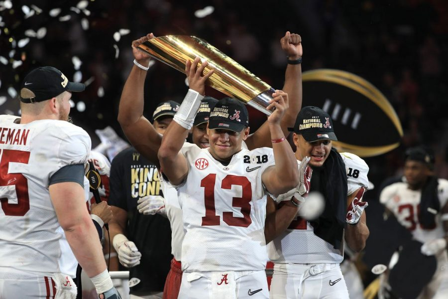 Alabama+QB+Tua+Tagovailoa+hoists+the+championship+trophy+after+leading+the+Crimson+Tide+to+a+comeback+victory.