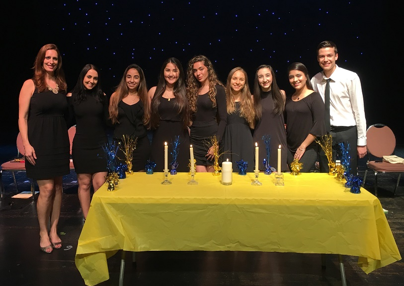 Olympic Heights National Honor Society adviser Ms. Vanessa Koher (left) with NHS officers at the 2018 induction ceremony.