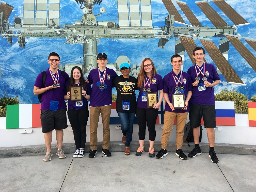 The first place Olympic Heights Astronaut Challenge team: (from left) Jordan Rosen, Alexa Cole, Justin Condren, Miss Nimmi, Kaylee Cunningham, Benjamin Kaufman, and Alexander Glotov.