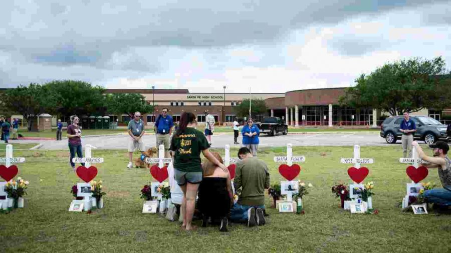 A+makeshift+memorial+to+the+10+murdered+Sante+Fe+High+School+students+was+erected+outside+the+school.