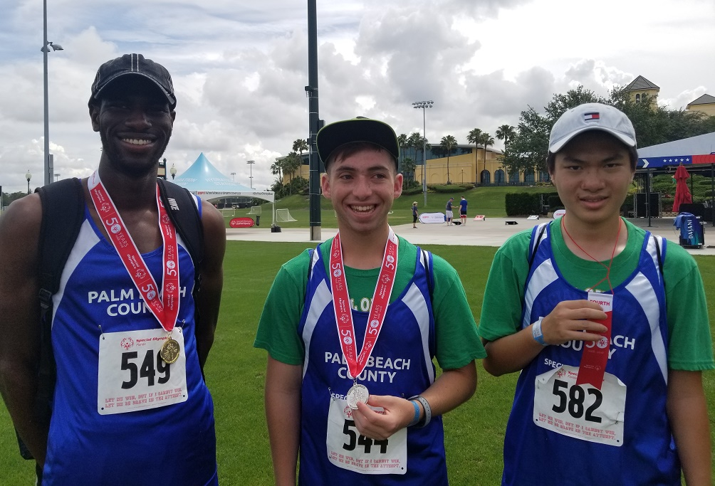 Olympic Heights Special Olympians (from left) Derrick Morgan, Ethan Litman, and Tai Zheng show off some of the hardware won at the State Games over the weekend of May 19.