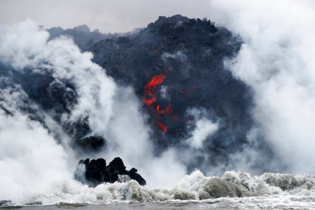 Lava from the Mount Kilauea volcano flows into the ocean near Pahoa, Hawaii.