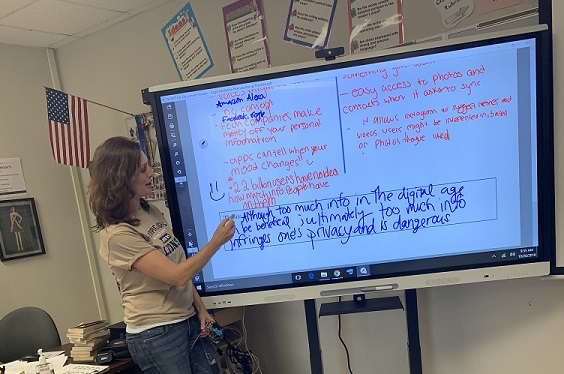 Ms. Vanessa Koher takes her AICE English General Paper class through a lesson utilizing her SMART Board.