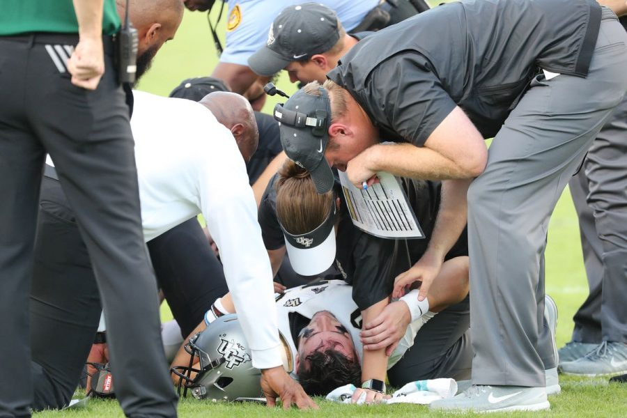 UCF+QB+McKenzie+Milton+has+the+full+attention+of+the+team+medical+staff+after+severely+injuring+his+knee+in+the+Nov.+23+game+against+South+Florida.+