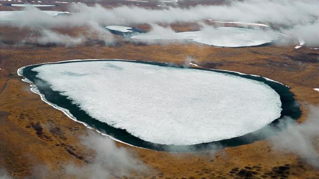 Viruses from the Black Death Plague or the 1918  flu pandemic could be released from the melting permafrost, such as is happening on the Siberian tundra above, as result of global warming.