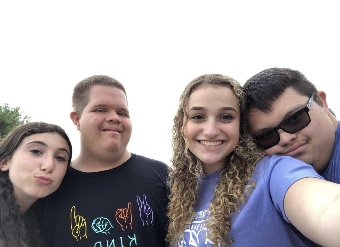 Members of the Olympic Heights Best Buddies Club include (from left to right): Marly Telchin, Roberto Alvarez, Rikki Siegel, and Andrew Chea.