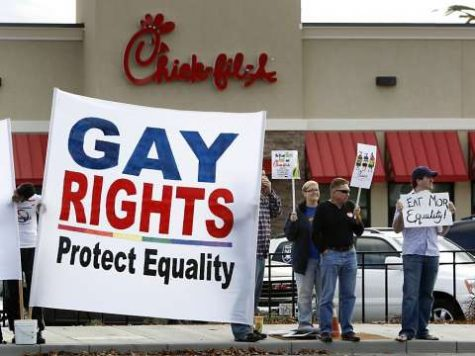 A pro-LGBTQ rights group protests Chick-fil-A donations to anti-LGBTQ organizations.