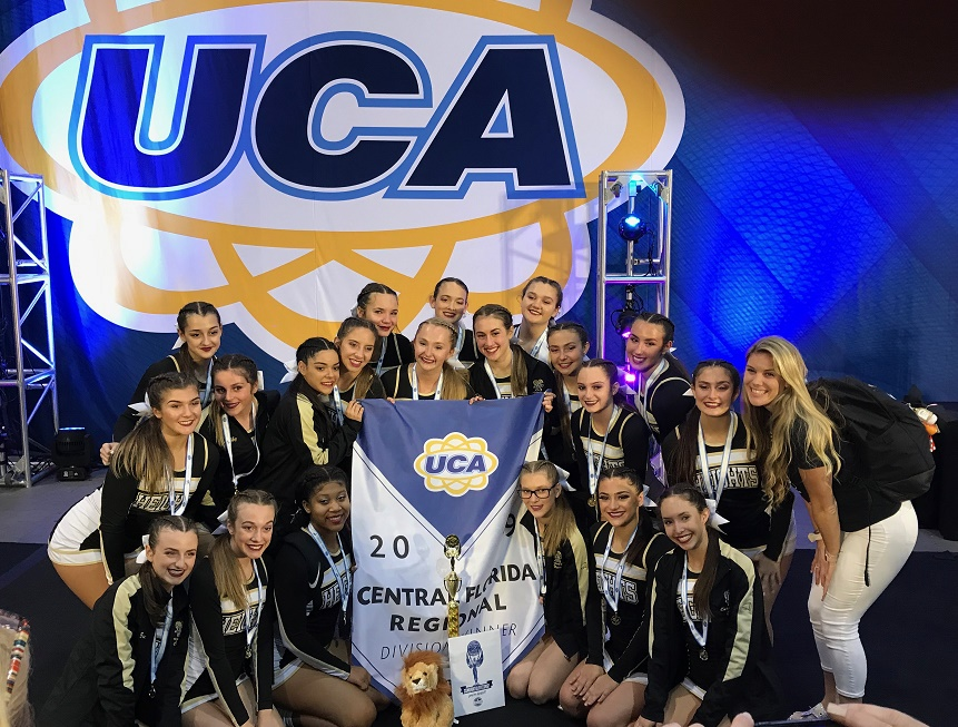 The Olympic Heights cheerleading team is all smiles after winning the UCA Regional Championship in Tampa.