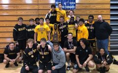 The Olympic Heights wrestling team ater winning the District 12-3A championship.