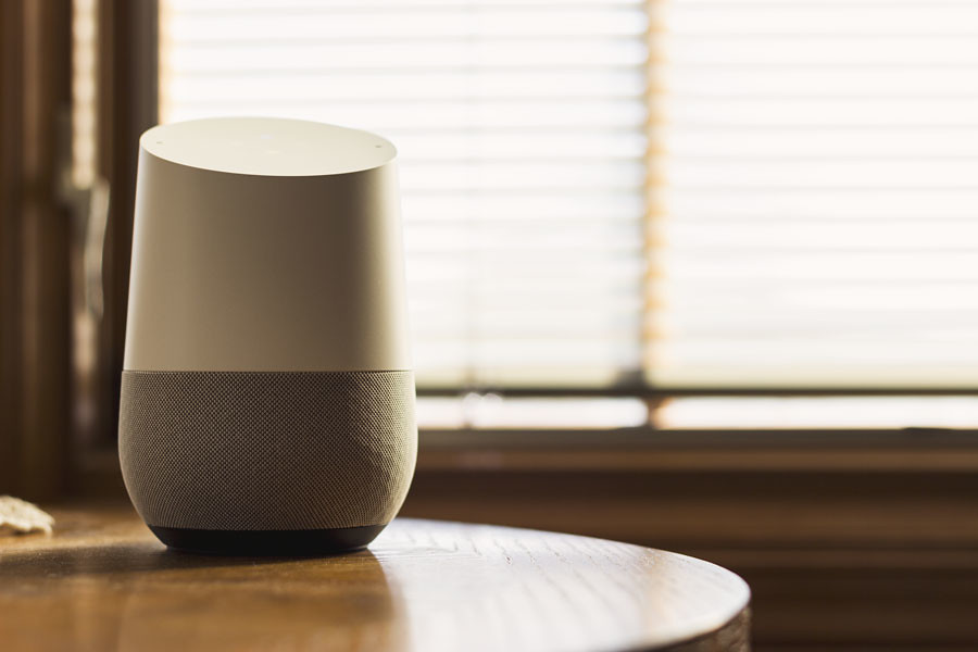 The Google Home device (above) is providing stiff competition to Amazon's Echo Dot.