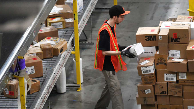 Many+of+Amazon%27s+warehouse+workers+feel+uneasy+about+the+lack+of+safety+precautions+taken+by+the+company+to+lessen+the+threat+of+coronavirus.