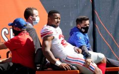 New York Giants star running back Saquon Barkley is carted off the field after suffering a season-ending torn ACL in last Sunday's loss to the Chicago Bears.