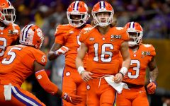 Quarterback Trevor Lawrence, #16, and the Clemson Tigers are the early favorites to win the 2020 COVID-19 altered season's championship