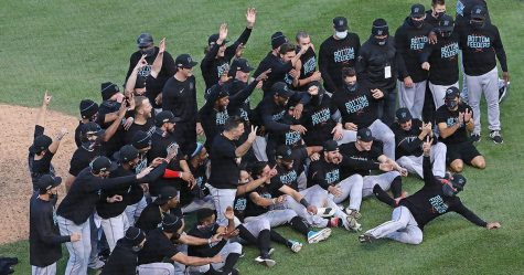 The Miami Marlins celebrate their Wild Card Series playoff win over the Chicago Cubs, and now move on to play the Atlanta Braves in the National League Division Series.