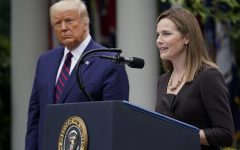Supreme Court justice nominee Amy Coney Barrett addresses the gathering at her nomination announcement as President Donald Trump looks on.