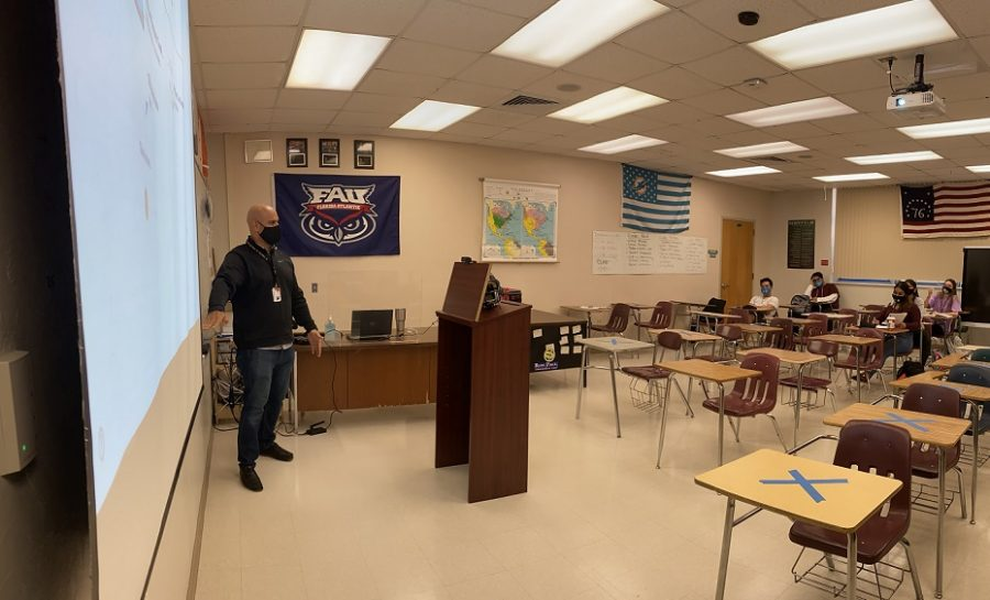 Olympic Heights social studies teacher Mr. Carlos Ramon, seen here teaching his fourth period class, was happy to return to campus to interact with students and other faculty in person.
