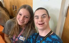 Olympic Heights Best Buddies club members Emily Nomberg (left) and Ben-tzion