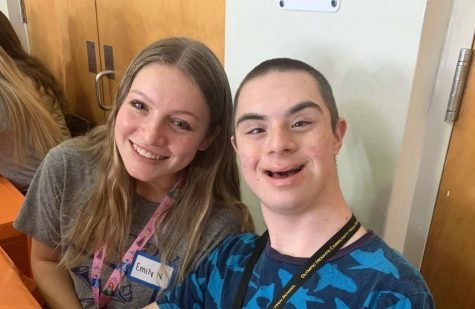 "Olympic Heights Best Buddies club members Emily Nomberg (left) and Ben-tzion ""Bentzy"" Stein (right) at a pre-COVID-19 club get-together last school year."