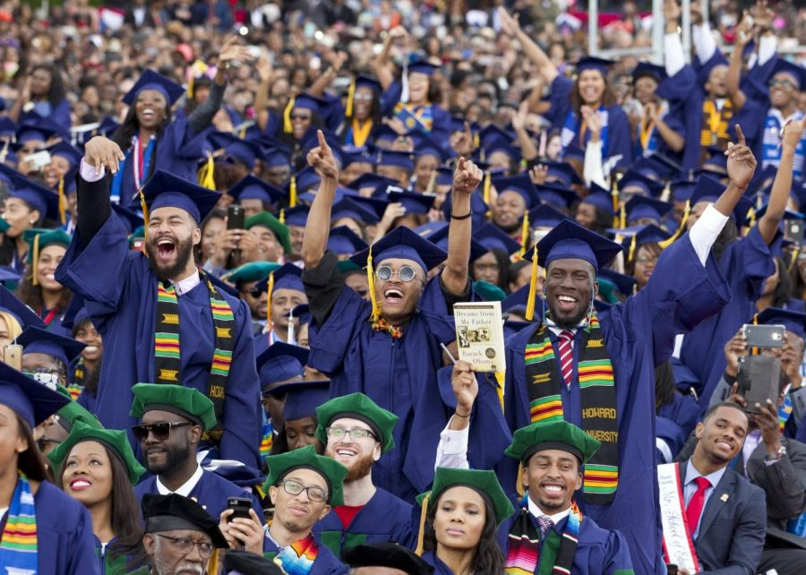 Howard University graduates celebrate at their commencement ceremony.