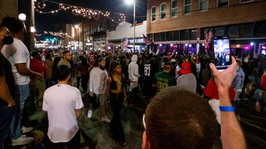 Large crowds gathered in Tampa's Ybor City district on Super Bowl eve, ignoring all safety protocols.