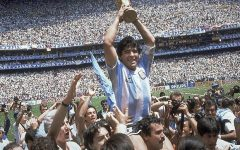 Diego Maradona, who passed away at age 60 on Nov. 25, 2020, holds up his team's trophy after Argentina's 3-2 victory over West Germany at the World Cup final soccer match at Atzeca Stadium in Mexico City.