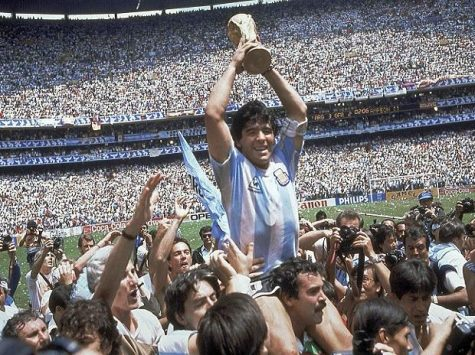 Diego Maradona, who passed away at age 60 on Nov. 25, 2020, holds up his team