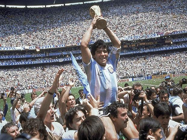 Diego+Maradona%2C+who+passed+away+at+age+60+on+Nov.+25%2C+2020%2C+holds+up+his+team%27s+trophy+after+Argentina%27s+3-2+victory+over+West+Germany+at+the+World+Cup+final+soccer+match+at+Atzeca+Stadium+in+Mexico+City.