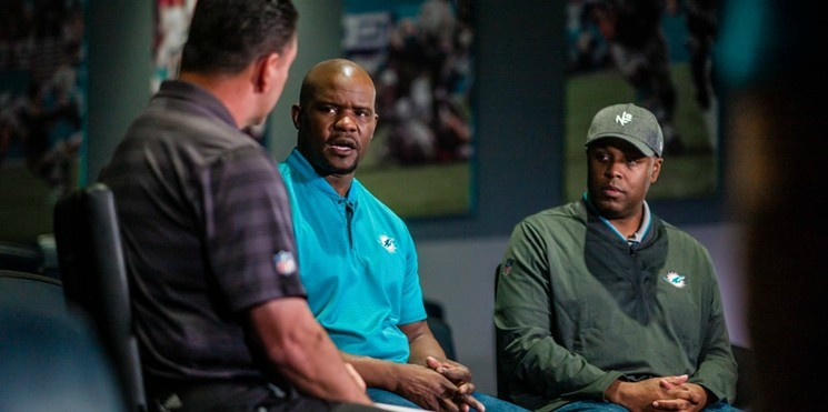 Miami Dolphins head coach Brian Flores (center) and General Manager Chris Grier (right) have been at the forefront of a rebuilding process that began with Flores' hiring after the 2018 season.