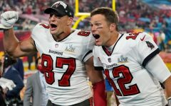 The Tampa Bay Bucs' Tom Brady (12) and Rob Gronkowski (87) return to New England to face the Patriots in week four of the NFL season.