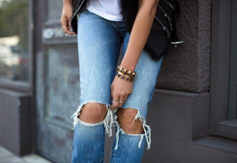 Fashion psychology drives many clothing trends, such as wearing ripped jeans.