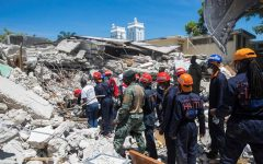 Search and rescue workers search the rubble for survivors amid the devastation of Haitis Aug. 14, 2021, earthquake.
