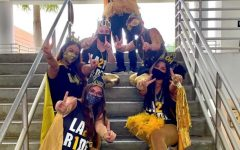Olympic Heights SGA members model their outfits for Homecoming Spirit Weeks Black and Yellow Day.