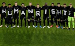 The German soccer team protests treatment of migrant workers used in preparing for the 2022 FIFA World Cup in Qatar.